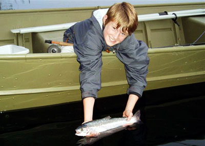 Daniel Stewart with rainbow trout on Nimpo Lake